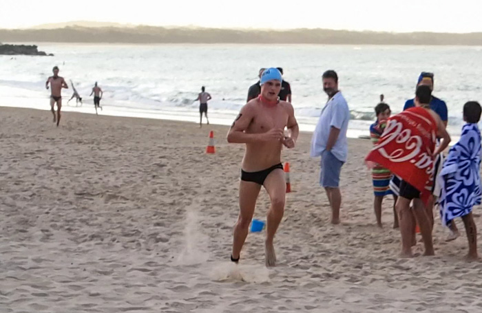 Open Run Swim Run Male winner finishing - Robbie Hayes